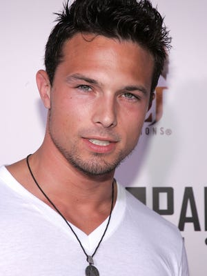 "TV actor Ricardo Medina Jr., seen here in a 2005 file photo at the premiere of reality show ""Dirty Love"" in Hollywood, was arrested on suspicion of murder for allegedly killing his roommate with a sword, Saturday, Jan. 31, authorities said."