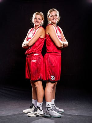 USD players Bridget (right) and Allison Arens.