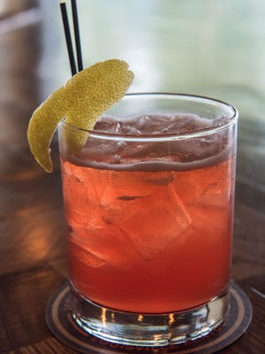 """The Candle-Lit Harvest beer cocktail with rhubarb syrup, lemon juice, Campari Liqueur, Old Fitzgerald Bourbon and Monnik I.P.A., as prepared by Brandon """"Habi"""" Habenstein, the bar manager for Monnik at 1036 E. Burnett Ave. in Schnitzelberg. May 5, 2016"""