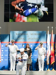An American flag is presented in honor of the fallen during the Gold Star Remembrance ceremony at the National Museum of Naal Aviation at Naval Air Station Pensacola on Thursday, September 22, 2016.