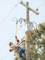 Apprentice line technician Tyler Barry  disconnects the riser leading to the transformer during an exercise at the Gulf Power training facility in Pensacola on Sept. 23.