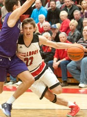 New Albany guard Isaac Hibbard collides with Bloomington South guard Leal Anthony on his way to the basket. Anthony was called for the blocking foul. 26 November 2016