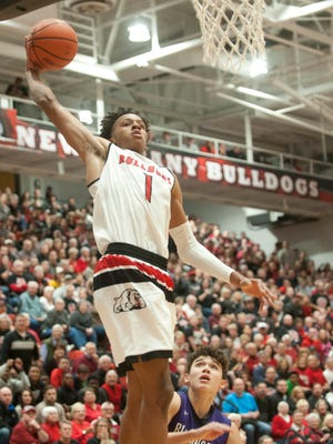 New Albany guard-forward Romeo Langford beats Bloomington South guard Leal Anthony to the basket on a fast break.26 November 2016
