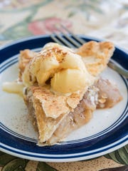 Ice cream or flavored cream toppings add zest to an apple pie.