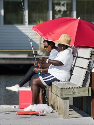 Deborah Robinson and Bea Laster, enjoys the day fishing from the pier of the Bayou Texar boat ramp Monday, Sept. 25, 2017. Over the next year, CivicCon will explore community conversations that can all Pensacola residents improve their quality of life.