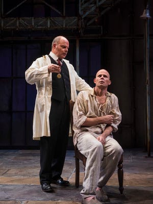 """Mark Corkins (left) and Rex Young perform in """"Holmes  and Watson,"""" performed by Milwaukee Repertory Theater."""