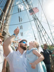 Justin Hick, of Lucedale, Mississippi, points out the high rigging to his daughter Scarlett, 4, on board the Elissa during the Tall Ships Festival at Plaza de Luna in downtown Pensacola on Friday, April 13, 2018.