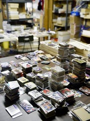 Stacks of sports cards stand as tribute to Jeff Jackson's larger collection in the back of his shop, as seen Thursday, May 5, 2016, at JJ's Antiques, Toys & Baseball Cards in Red Lion. Jeff Jackson, a full-time roofer who has been selling cards out of Red Lion since 1983, estimates he has 15-20 million cards between his shop, warehouse and home.