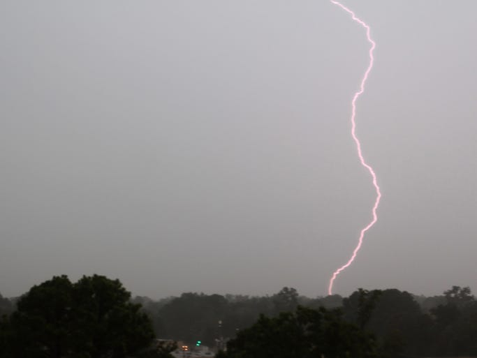 A bolt of lightning strikes down in Monroe during a thunderstorm Monday afternoon. Northeastern Louisiana will remain under a severe thunderstorm warning until 8:15 p.m.