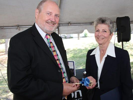 Peer Lauritsen of Oticon with Councilwoman Rozalyn Sherman