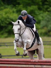 Michael Desiderio is shown riding Zero Tolerance in