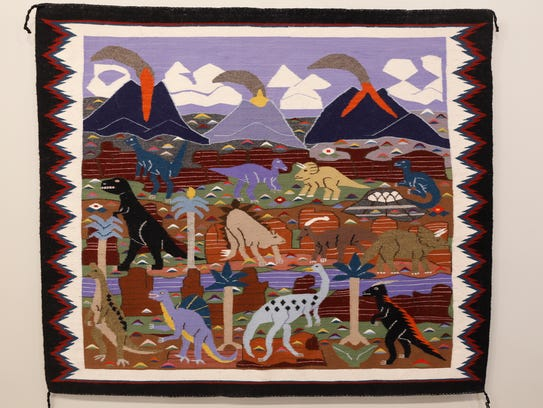 "A rug depicting dinosaurs that is part of the ""Patterns from Places"" exhibition is displayed Thursday at the Museum of Navajo Art and Culture in Farmington."