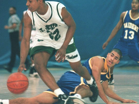As a guard at St. Joseph-Metuchen, Jay Williams dribbles past North Brunswicks Tim Howard in 1998.