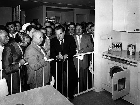 U.S. Vice President Richard Nixon (in the dark suit)