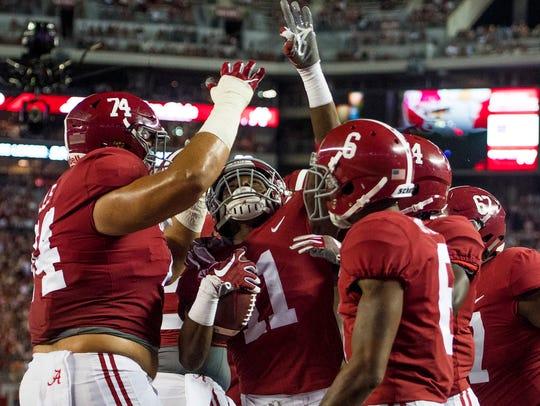 Alabama wide receiver Henry Ruggs III (11) celebrates