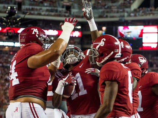 Alabama wide receiver Henry Ruggs III (11) celebrates with teammates after scoring a touchdown against Ole Miss in second half action at Bryant-Denny Stadium in Tuscaloosa, Ala. on Saturday September 30, 2017. (Mickey Welsh / Montgomery Advertiser)