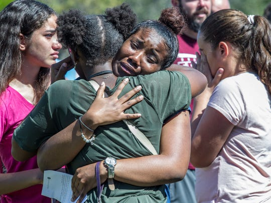 Milan Hamm, center, 17, joins hundreds of community members at a prayer vigil at Parkridge Church in Parkland, FL on February 15, 2018. Members of the community gathered for a vigil for the victims of the mass shooting at Marjory Stoneman Douglas High School.