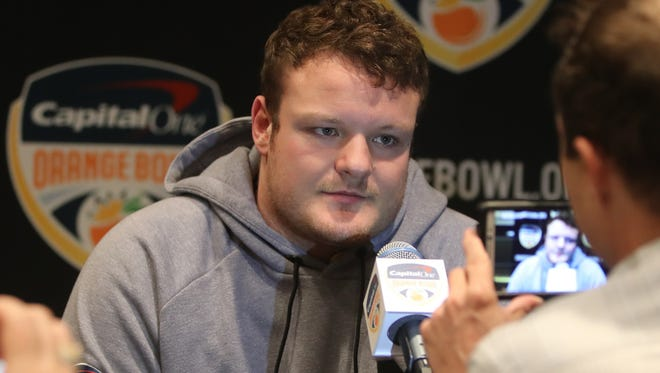 Michigan Wolverines defensive lineman Ryan Glasgow talks with reporters in Dec. at the Renaissance Fort Lauderdale Cruise Port Hotel in Fort Lauderdale, Fla.