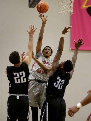 Spiece Indy Heat Gym Rats Marcus Bingham Jr. (4) shoots over Howard Pulley Panthers Daniel Oturu (32) and Gabe Kalscheur (22) during their Elite Youth Basketball League game Saturday, April 29, 2017, afternoon at the Jonathan Byrd's Fieldhouse at Grand Park in Westfield.