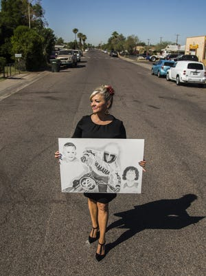 Toinette Benson stands on the corner of Palm Lane and 35th Avenue where her brother, Todd Mertes, was killed. Portrait taken on Oct. 8, 2017.