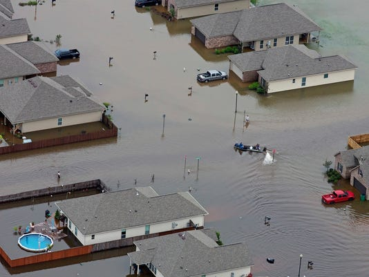 636095465380608516-Louisiana-Flooding-Le-Thom.jpg