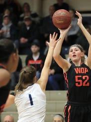 West De Pere's Hannah Stefaniak (52) shoots over Bay