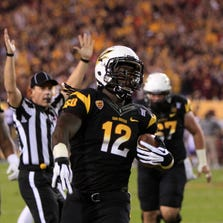 De'Marieya Nelson scores a touchdown during the second quarter of the Territory Cup college football game against Arizona at Sun Devil Stadium in Tempe.