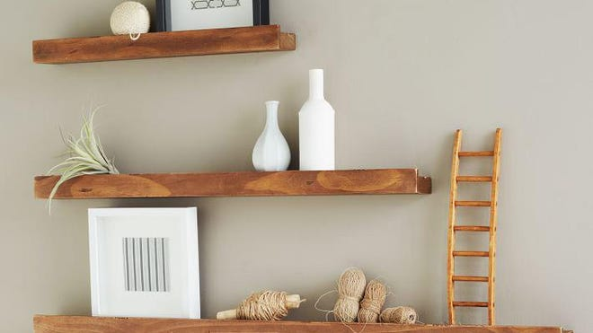 Deep Picture Ledge made of salvaged wood, $45 to $65 each at West Elm.