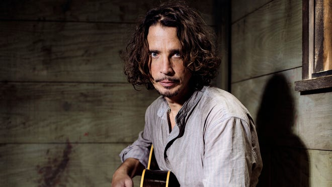 Chris Cornell plays guitar during a portrait session at The Paramount Ranch in Agoura Hills, CA in July 2015.