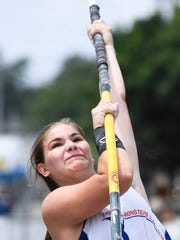 Catlin Gillihan eyes the bar as she puts her weight on the pole during the Jammin' & Jumpin' Street Vault event at the Henderson riverfront Tuesday, July 4, 2017.