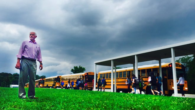 Retiring White House Middle School Principal Jerry Apple watches students at they leave on theirs and his very last day of school on Thursday, May 26, 2016.