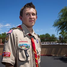 In order to become an Eagle Scout, Kyle Tucker wants to put up a flagpole at the back of the parking lot at his Avondale charter school. The boy won his battle. <137,2014/08/28,Koerth/c Kimberly1>The <137><137,2014/08/28,Koerth/c Kimberly1>school and its neighbors approved it a couple of years ago. But now the association of other owners in the business park want the school to add a $650,000 indemnity rider to its already $3 million insurance. Kyle poses near the proposed site on Friday, Aug. 22, 2014.<137>