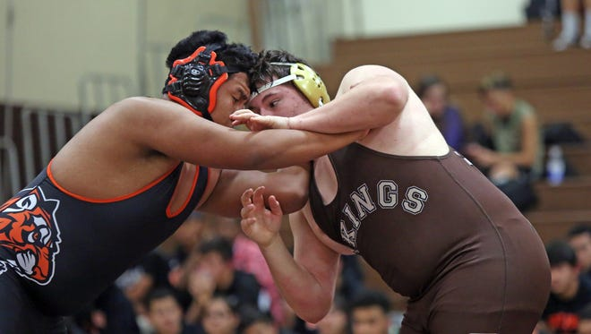 White Plains Jesus Guallpa and Clarktown South's Sal Iodice wrestles in the 285 pound match during opening round of the Section 1 Wrestling Dual Meet Championships with  Clarkstown South, Eastchester, Port Chester and White Plains at Clarkstown South High School in West Nyack Dec. 7, 2016