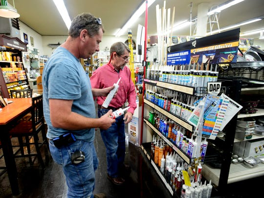 Pensacola Hardware Co. salesman Sam Haas helps customer Jason Nelson find some adhesive Monday at the hardware store. The store has been in business since 1851, making it one of the oldest retail stores in Florida.