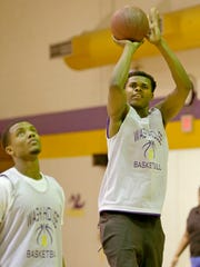 FOSTER - Milwaukee Washington High School prep basketball freshman standout Michael Foster Jr., a 6-9 forward who has already committed to Arizona State, shoots next to teammate Deontay Long, a junior, as they practice at Washington High School,on N. Sherman Blvd, in Milwaukee on Thursday, December 21, 2017.  -  Photo by Mike De Sisti / Milwaukee Journal Sentinel