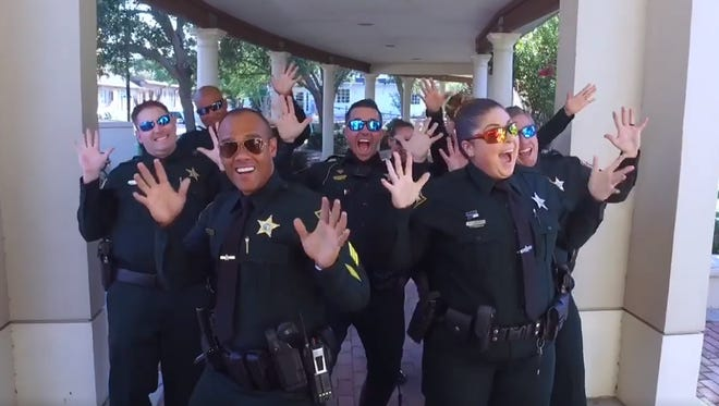 Brevard County Sheriff deputies rock their jazz hands at the conclusion of the video.