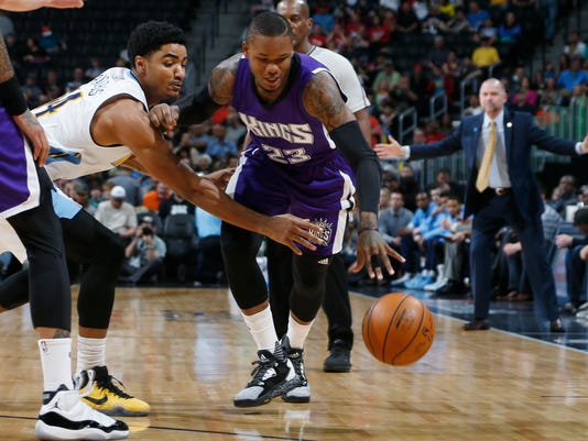 Denver Nuggets guard Gary Harris, left, tries to steal the ball as Sacramento Kings guard Ben McLemore drives for the basket in the first half of an NBA basketball game Saturday, April 2, 2016, in Denver. (AP Photo/David Zalubowski)