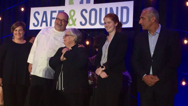 Jennifer and Joe Bartolotta (left) stand with members of the Italian Community management team (left to right) Barb DeMeulenaere, Whitney Sleiter and Adam Iplikci at an awards gala for the organization Safe & Sound in Milwaukee.