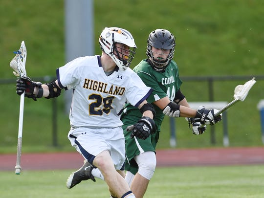 Highland's Dylan Cuvelier keeps the ball away from Cornwall's Dominick Fayo during Wednesday's game at Highland. Cuvelier went on to score seven goals during the game.