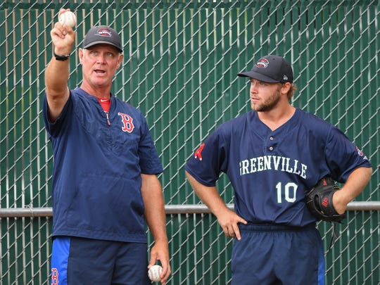 Greenville Drive pitching coach Bob Kipper works with pitcher Durin O'Linger Thursday, June 14, 2018 at Fluor Field at The West End.