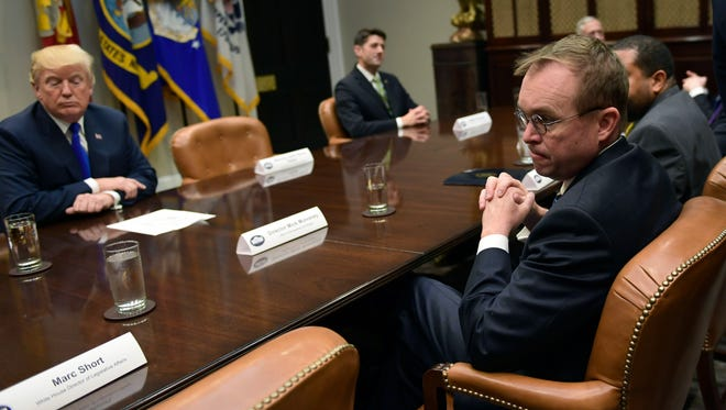 File photo shows White House budget director Mick Mulvaney, right, at a White House meeting with President Trump, who named him the acting director of the Consumer Financial Protection Bureau.