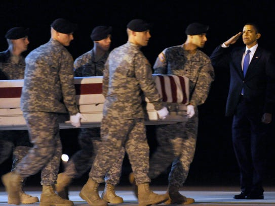 President Obama salutes with Maj. Gen. Daniel Wright