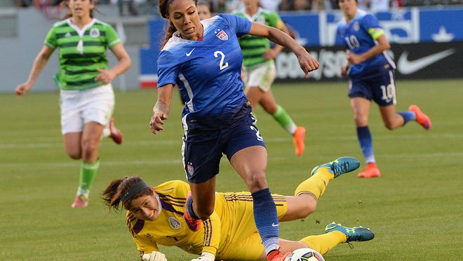 Sydney Leroux (2) gets by Mexico goalkeeper Cecilia Santiago (1) as she heads toward the goal in the first half.