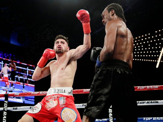 Jose Ramirez, left, follows through on a left to Amir Imam during the third round of a WBC super lightweight championship boxing match Saturday, March 17, 2018, in New York. (AP Photo/Frank Franklin II)