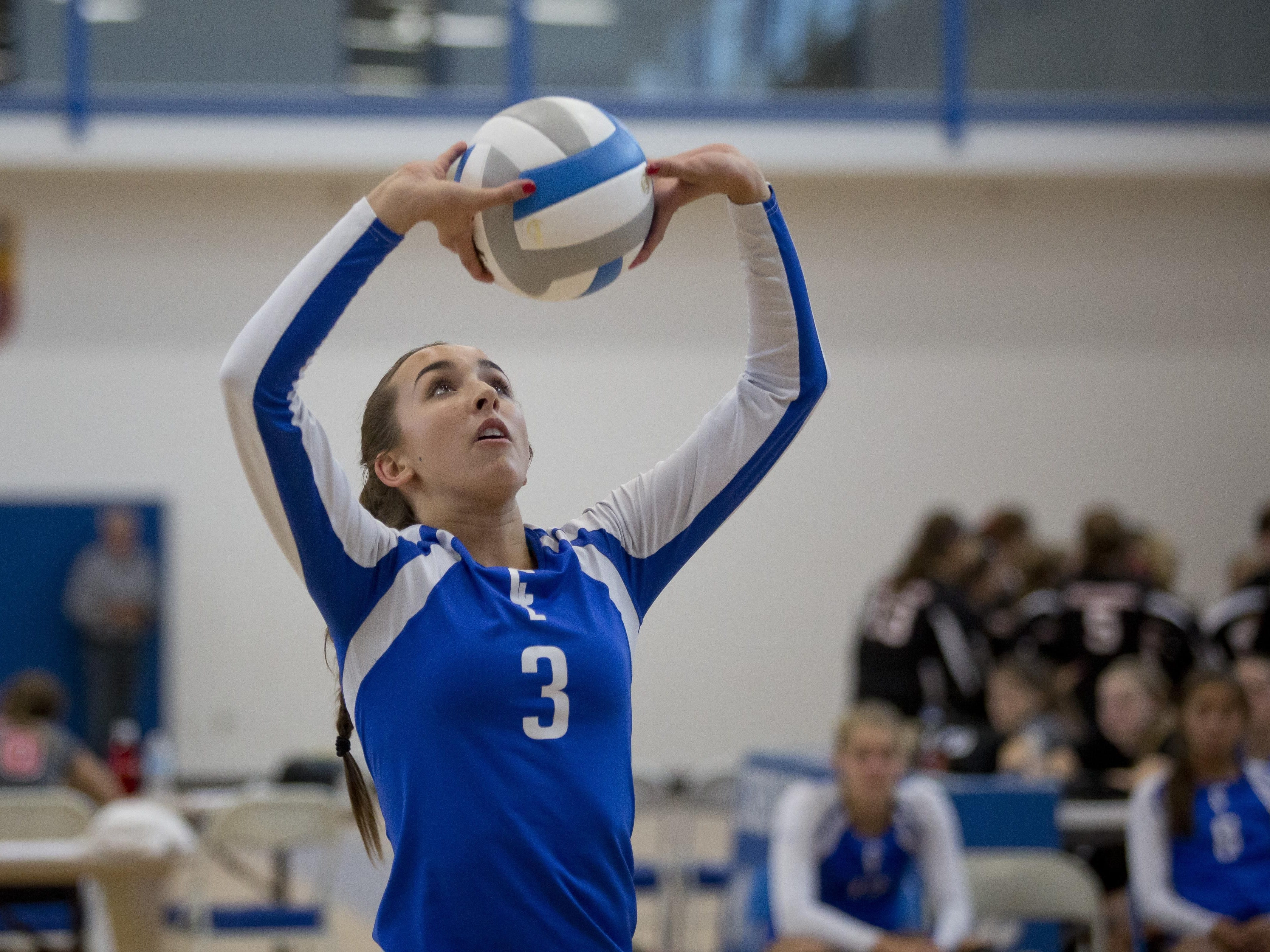 Cros-Lex's Rachel Soper sets the ball during the Pioneer Volleyball Invitational Saturday, September 12, 2015 at Cros-Lex High School.