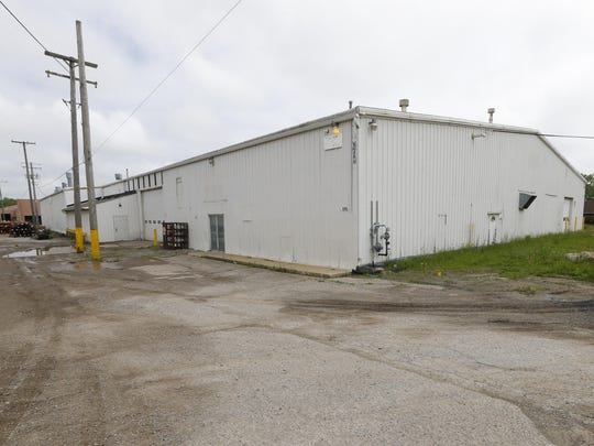 The exterior of a former location for Opus Bono Sacerdotii is shown in Dryden, Mich., on June 6, 2019. For nearly two decades, the group has operated out of a series of unmarked buildings in rural Michigan, providing money, shelter, transport, legal help and other support to Catholic priests accused of sexual abuse across the country. (AP Photo/Paul Sancya)