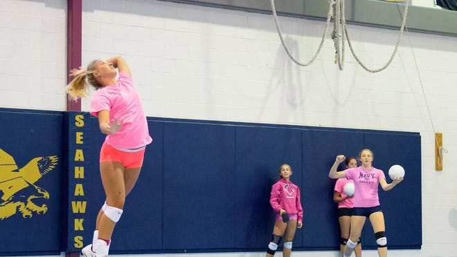 Cassie Kowalski serves for Delaware Military Academy's girls volleyball team.
