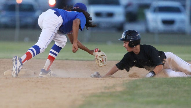 Indio High School varsity shortstop, Emiliano Torres makes a tag on Xavier  Prep's Dylan Sykes at second base during the game at Shadow Hills High School in Indio.