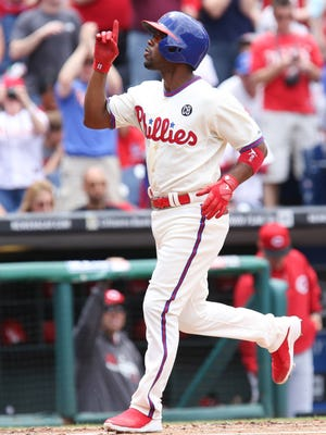 Phillies shortstop Jimmy Rollins celebrates after hitting a home run Sunday.