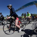 Cyclists leave the starting gate in the Tour de Lou bike ride. Riders could choose between a 35 mile or 20 mile ride. Both rides will tour the Olmstead Parks of Louisville.